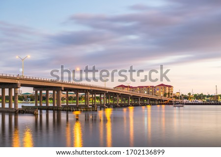 Bradenton, Florida, USA downtown on the Manatee River at dusk.