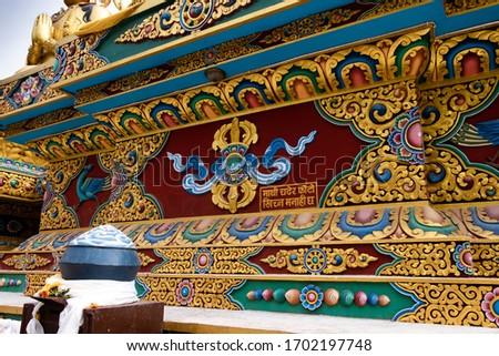 The art just below the goldern statue of Buddha at Buddha Park, Swayambhunath, Kathmandu, Nepal. Translation of Nepali word: Please don't climb up and take photos. #1702197748