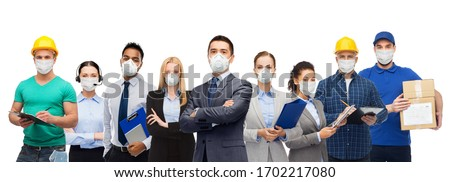 health care, quarantine and business concept - group of people of different jobs wearing protective medical masks for protection from virus Royalty-Free Stock Photo #1702217080