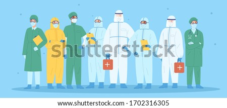 Group of medical workers in personal protective equipment. Physicians, nurses, paramedics, surgeons in workwear. Hospital team standing together wearing uniform or protection suit. Vector illustration Royalty-Free Stock Photo #1702316305