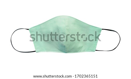 Green pastel cloth face mask isolated on white background with clipping path. Due to lack of medical protective masks during Coronavirus (COVID-19) pandemic, healthy people instead wear cotton masks. #1702365151