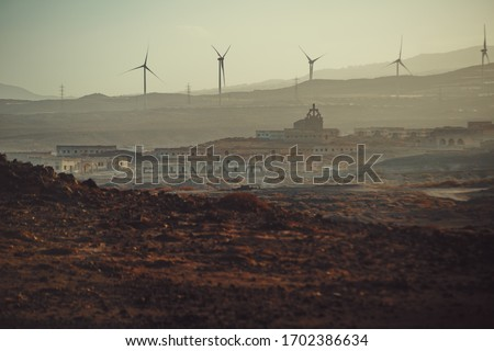 post-apocalyptic desert landscape in the apocalypse Royalty-Free Stock Photo #1702386634