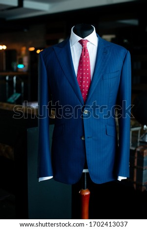navy blue jacket and tie on mannequin  #1702413037