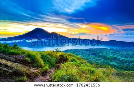 Sunset mountain valley rock landscape. Mountain peak sunset landscape. Sunset in mountains Royalty-Free Stock Photo #1702431556