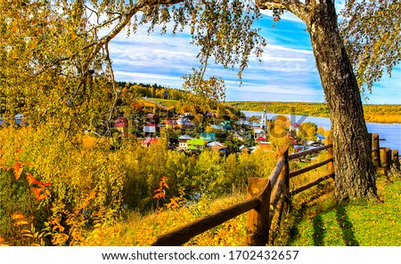 Autumn river village tree fence view. Autumn village landscape. Autumn village view. Village in autumn #1702432657