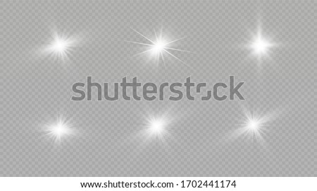 Light effect. Bright Star. Light explodes on a transparent background. Bright sun. #1702441174