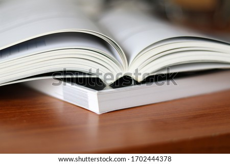 Book, Thick heavy books with white paper and hard cover, good binding, perfect binding, large number of pages, huge page booklet Royalty-Free Stock Photo #1702444378