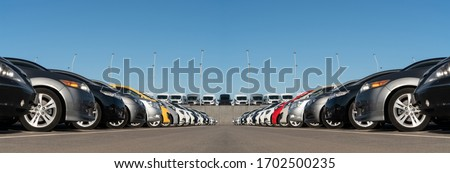 Panorama of cars market. Used car sales Royalty-Free Stock Photo #1702500235
