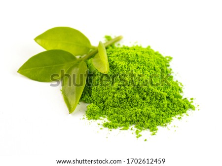dry green tea powder matcha tea with whole leaves, isolate on a white background. Chinese healing soothing tea for health. Eastern grass #1702612459