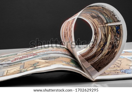 initiation to reading with comics Royalty-Free Stock Photo #1702629295