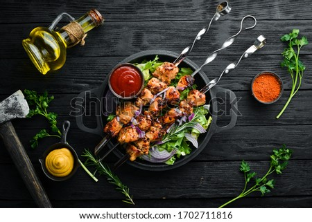 Juicy chicken skewers with rosemary and spices. Top view. Barbecue. #1702711816