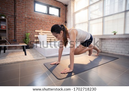 """Asian women exercise indoor at home she is acted """"Mountain climber"""" #1702718230"""