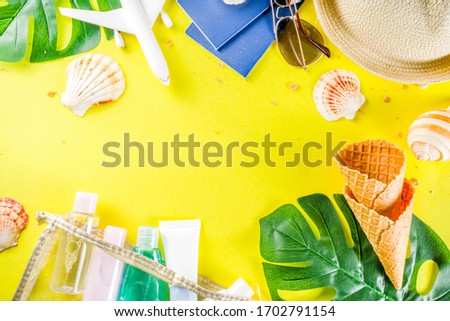 Travel and vacation flatlay concept. Summer bright colorful background with hat, sunglasses, plane,  passport, tropical leaves, travel cosmetics kit, seashells, copy space top view banner #1702791154