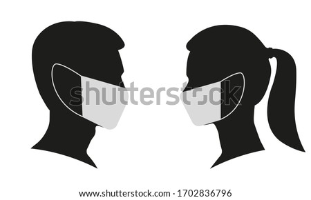 Man and Woman profile face silhouette in medical mask. Male and female head illustration. Vector illustration.  Royalty-Free Stock Photo #1702836796