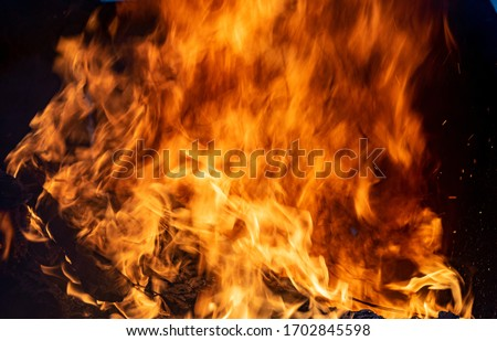 The fire, burning debris, there is no focus. Large burning fire. #1702845598