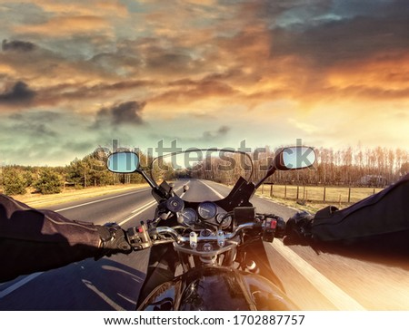 riding a motorcycle on the road on a sunny day #1702887757