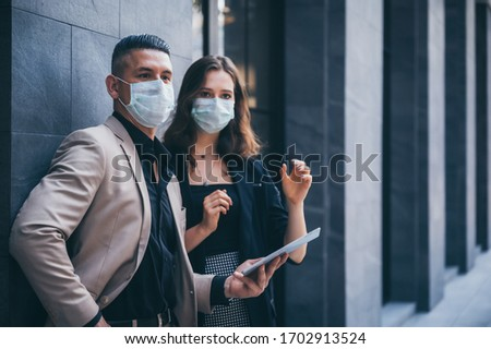 business worker wearing a protective mask in the city #1702913524