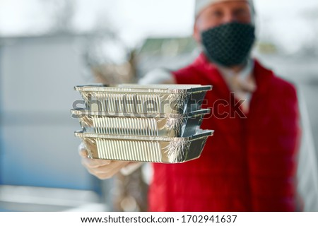 Courier hold go box food, delivery service, Takeaway restaurants food delivery to home door. Stay at home safe lives from coronavirus COVID-19 outbreak. Delivery service under quarantine. #1702941637