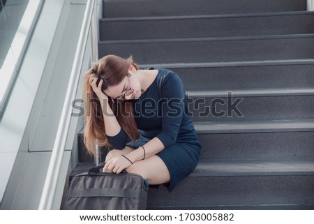 Asia woman stressed from work sitting on steps outside feeling anxiety in adult cause of depression and problem in living that makes you feel lonely, sad and worried in mental health concept. #1703005882