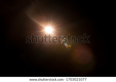Abstract Natural Sun flare on the black #1703021077