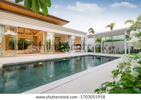 Exterior design of pool villa, house and home feature infinity swimming pool and garden #1703055958