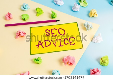 Writing note showing Seo Advice. Business photo showcasing guidance or recommendations in enhancing the search engine Colored crumpled papers empty reminder blue yellow clothespin.