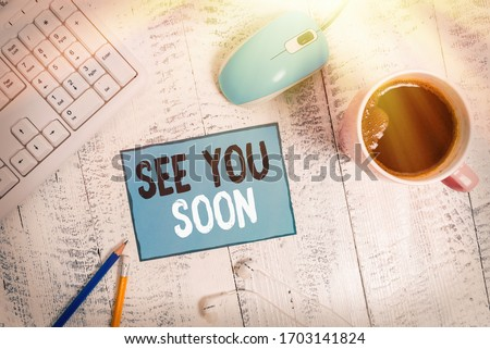 Text sign showing See You Soon. Conceptual photo used for saying goodbye to someone and going to meet again soon technological devices colored reminder paper office supplies keyboard mouse. Royalty-Free Stock Photo #1703141824
