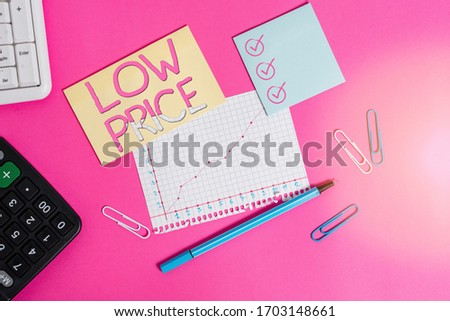 Text sign showing Low Price. Conceptual photo Price are the lowest in relation to other things of same kind Stationary and note paper plus math sheet with diagram picture on the table.
