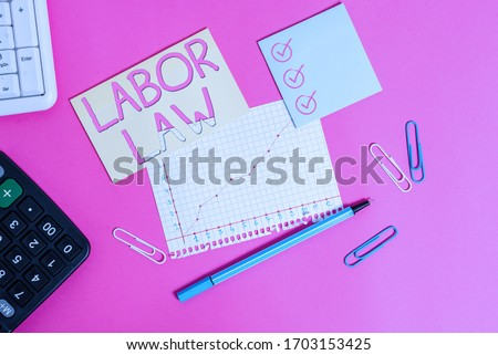 Text sign showing Labor Law. Conceptual photo rules relating to rights and responsibilities of workers Stationary and note paper plus math sheet with diagram picture on the table.