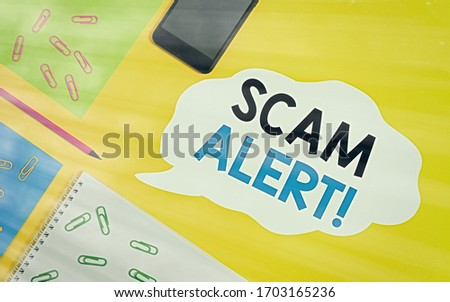 Conceptual hand writing showing Scam Alert. Business photo showcasing warning someone about scheme or fraud notice any unusual Sheets message pencil smartphone plain colored background.