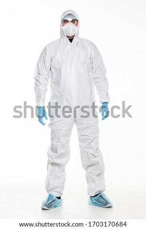 Man in chemical protective suit making stop gesture on white background. Virus. Royalty-Free Stock Photo #1703170684
