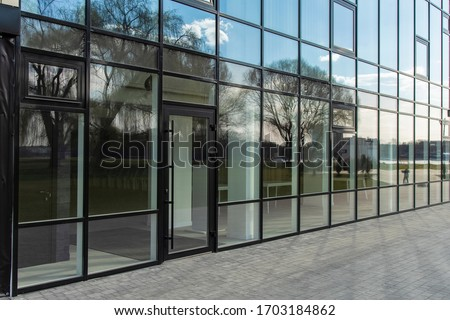 office center glass exterior wall building paved street walk side urban modern architecture background picture