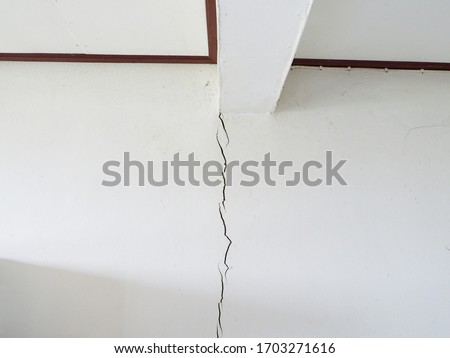 Earthquake damaged to the walls of the home. Cracked wall from earthquake damage. #1703271616