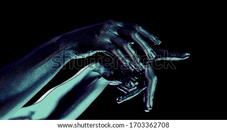 female hands moving in black background, closeup of palms, split of picture and changing colors
