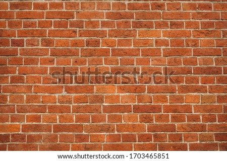 brick red wall. background of a old brick house. #1703465851