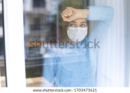 Young woman who cannot leave the house in quarantine due to an epidemic Covid-19 Royalty-Free Stock Photo #1703473621