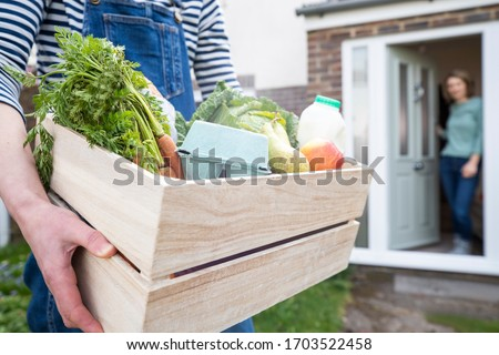 Home Delivery Of Fresh Produce Outside House Observing Safe Social Distancing During Coronavirus Covid-19 Pandemic #1703522458