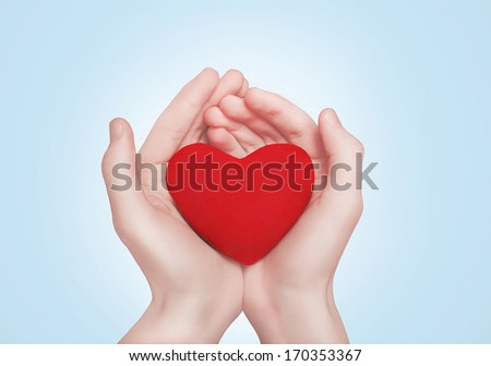 Open hands holding showing red heart over blue background #170353367