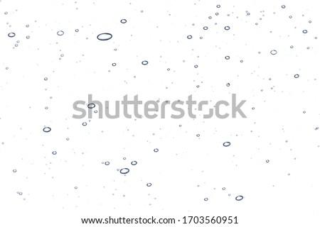 Clear liquid gel bubbles texture. Face serum, hand santizer swatch. Transparent liquid skin care product close up #1703560951