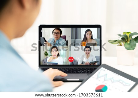 Group of young happy asian work from home meeting or brainstorming online video conference application on 5G internet with covid coronavirus business continuity plan via tablet or notebook computer. #1703573611