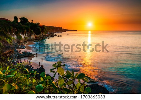 Scenic sea landscape, Bali. High cliff on tropical Pantai beach in Bali, Indonesia. Tropical nature of Bali, Indonesia. Beautiful blue sea water, white sand beach and green tropics of Bali shoreline #1703665033