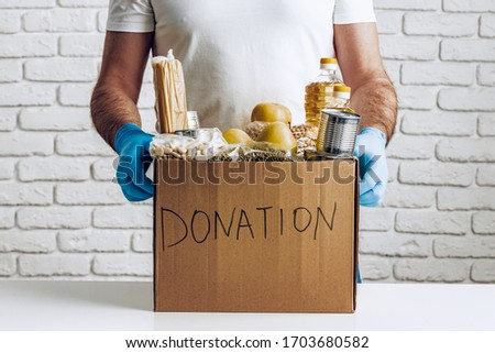 Donation box of food for people suffering from coronavirus pandemia consequences #1703680582