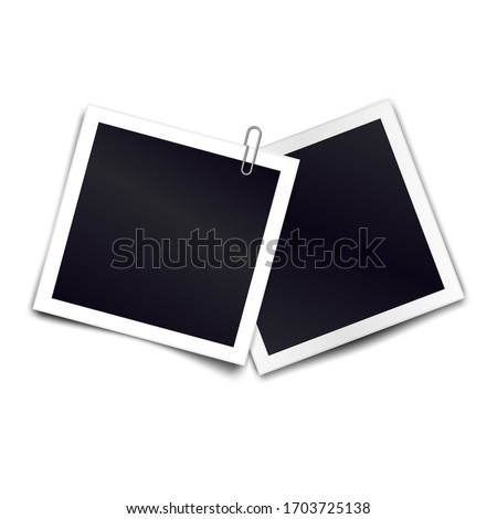 Photo frames with metal paper clip. Metal paper clip attached to two retro photorealistic photo frames on white background. Template for design