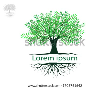 Tree and roots with green leaves look beautiful and refreshing.Tree and roots LOGO style. #1703761642