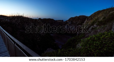 Beautiful panorama of an orange sunset at Pancake Rocks on a sunny winter day in Punakaiki, New Zealand #1703842153
