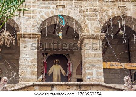 The magnificent icon of Jesus Christ. The inner monastery courtyard. Monastery of Gerasim of Jordan of the Jerusalem Orthodox Church. Israel. The concept of pilgrimage, religious and photo tourism
