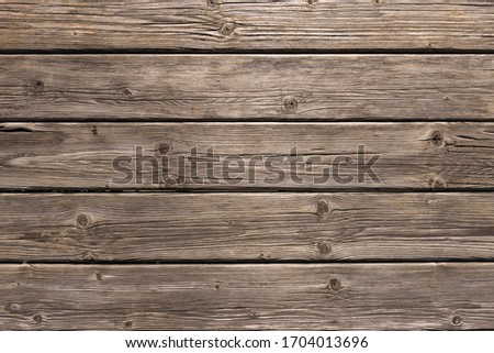 Dark wooden background texture. Old fence panels with natural patterns.