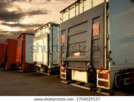 truck with lift door packing at sunset sky, road freight shipping cargo, logistics and transport #1704029137