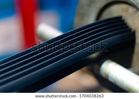 Rubber profile extruding in the factory Royalty-Free Stock Photo #1704038263
