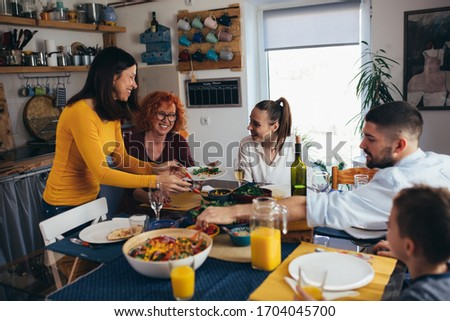 family gathering having dinner or lunch party at home #1704045700